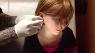 6 year old getting ears pierced using needle method