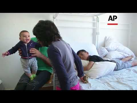 Afghan family struggle with life in Serbian migrant camp