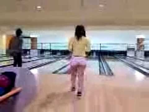 A girl is bowling  hotpants :