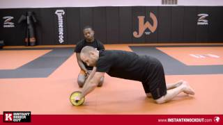 Ab wheel rollout tutorial for beginners with MMA coach Greg Jackson