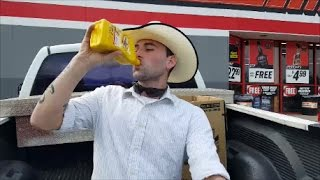 Man Drinks Motor Oil for Autism Awareness
