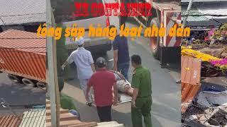 Xe container tông sập hàng loạt nhà dân