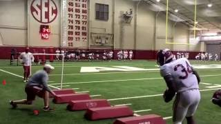Alabama's running backs working during the 24th practice