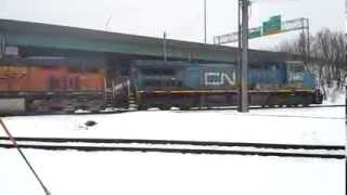 CN IC 2465 BNSF 6326 and CN 5458 in Cedar Rapids, Ia Feb 20, 2014