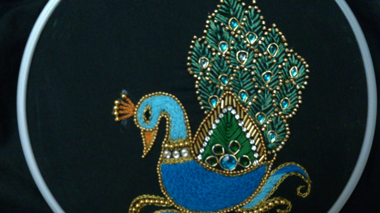 9fc05dd44e Hand embroidery designs. Aari style peacock embroidery for ghagras,  dresses, sarees and blouses.