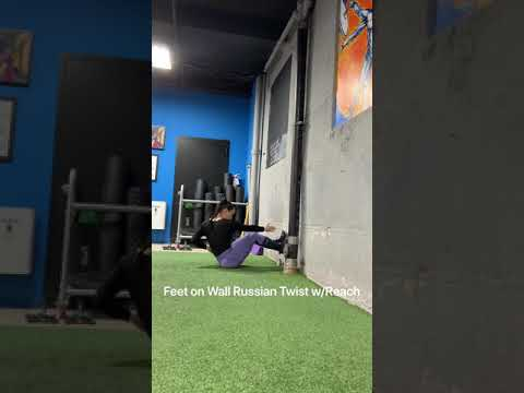 Feet On Wall Russian  Twist W/Reach