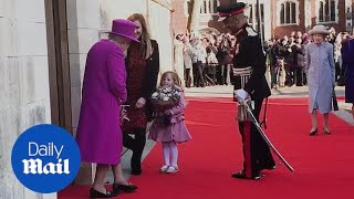Cute little girl presents Queen with flowers at Lincoln's Inn thumbnail