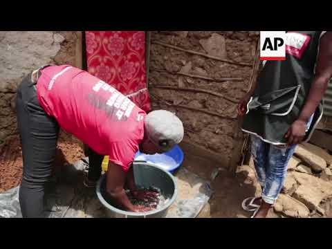 Kenya dump dwellers make a living recycling hair extensions
