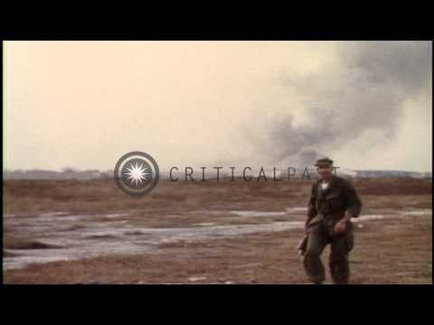 USAF personnel wait to attack Vietcong at Tan Son Entrance Air Base, Vietnam. HD Stock Footage