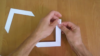 How to make a boomerang out of paper that is returned.