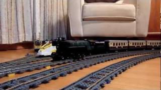 LEGO ICE 3, TGV, Eurostar, Emerald Night 10194, and Maersk 10219 trains on long curve layout