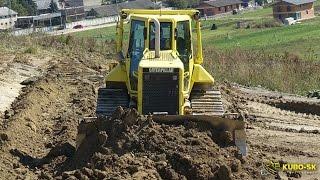 caterpillar d6n dozer pushing dirt
