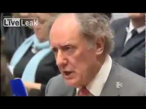 irish journalist shames ECB banker with tough questions on irelands debt.