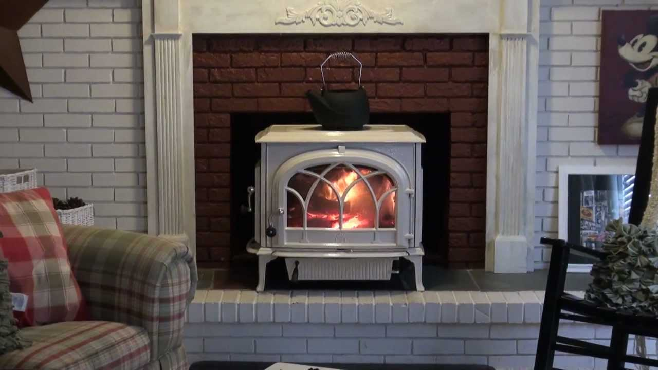 JOTUL F 500 OSLO WOOD BURNING STOVE SITTING IN FRONT OF THE FIREPLACE INSTALLED BY The Wood Stove & Fireplace Center Oakhurst NJ WITH A BLACK CAST IRON KETTL...