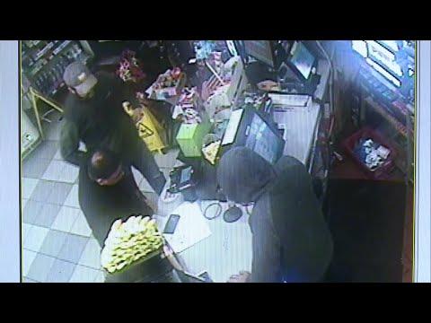 Surveillance Video: ICE Agents Interview 7-Eleven Clerk In Santa Rosa