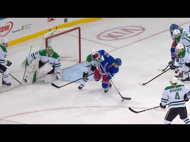 Jimmy Vesey makes a falling backhander look easy
