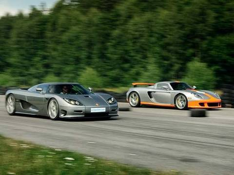 Porsche Carrera GT vs Koenigsegg CCR Evolution x 2 Races to 200 mph / 320 km/h