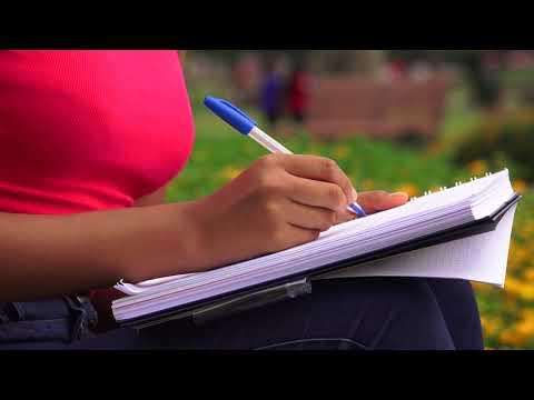 Female Teen Writing In Journal Or Notebook