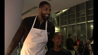 Cleveland Cavaliers players, coaches serve Thanksgiving dinner to young students