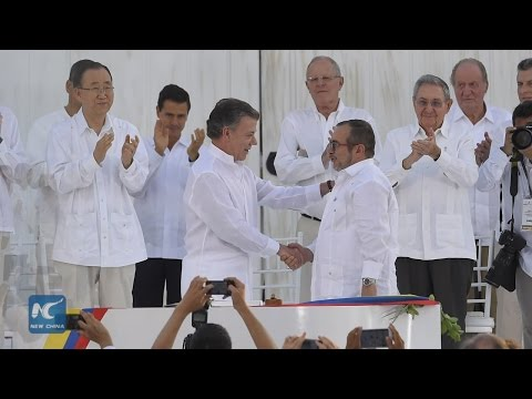 With full peace deal, Colombia says adieu to largest civil war in LatAm