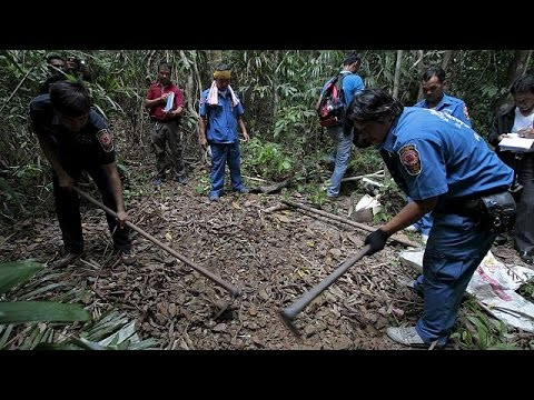 Malaysia: 140 suspected migrant graves found near Thailand