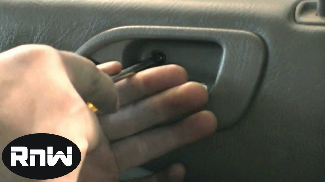 How to Remove the Rear Door Panel and the Interior Door Handle on a ...