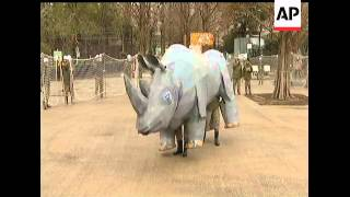 A Tokyo zoo stages an emergency drill on how to respond if rhinoceros were to escape from their encl