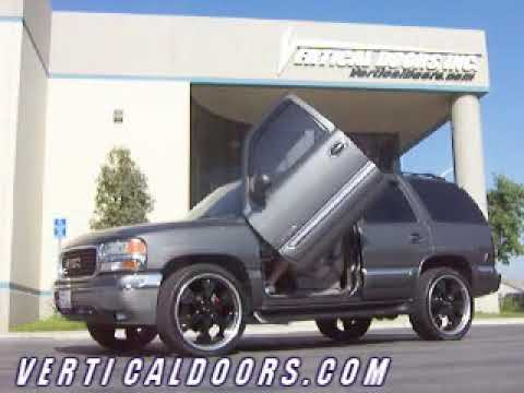 GMC YUKON, WITH VERTICAL DOORS, INC.