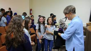 Trixie fistbumping with students in Quito, Ecuador