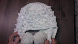 Вязание шапки крючком Шапка с ушками и помпонами Теплая(Вязание шапки крючком процесс доступный начинающим. Этот видео-урок вязания шапки с ушками и помпонами..., 2014-01-18T06:32:56.000Z)