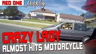 Crazy Lady Almost Hits Motorcycle (Road Rage)