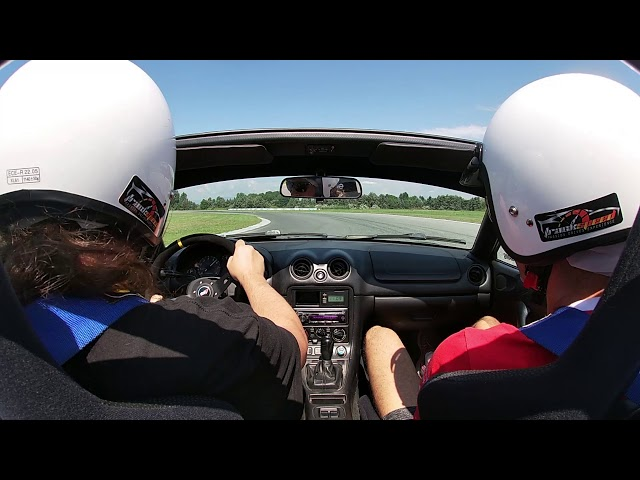 George gets the grip of our miata with  the instructors help.Track-speed.com