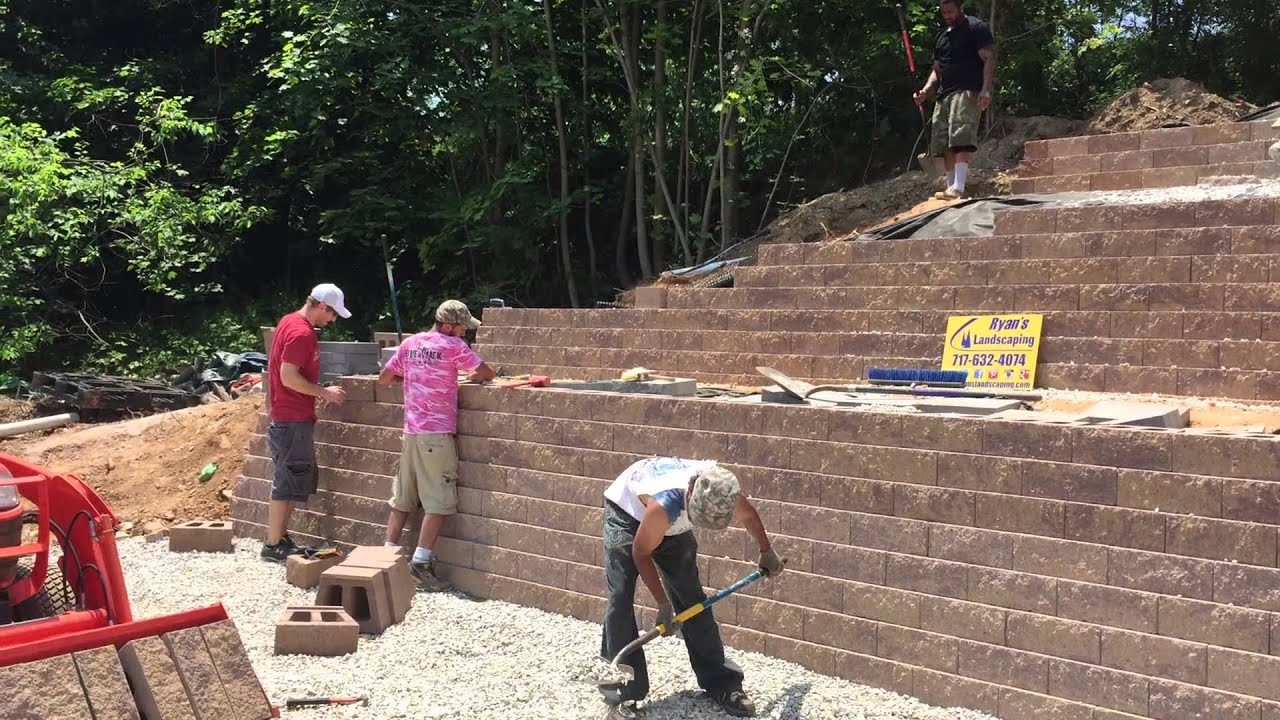 Tiered retaining wall hardscape for sloped hill Spring Grove York