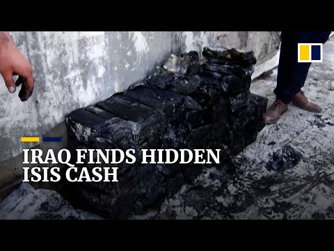 Isis stash containing hundreds of bags of seized cash uncovered in Iraqi city of Mosul