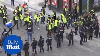 Strong police presence in Paris as protesters gather in the capital