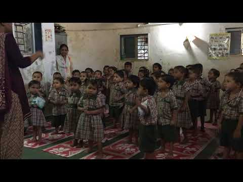 Nursery school students reciting their ABCs in Dharavi slum in Mumbai