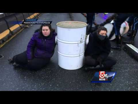 5 Investigates: Protesters handcuffed together through cement-filled barrels
