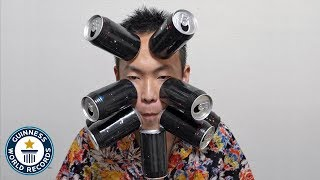 Cans stick to my skin! - Guinness World Records