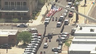 RAW: Honor guard escorts body of Phoenix police Officer Paul Rutherford to medical examiner