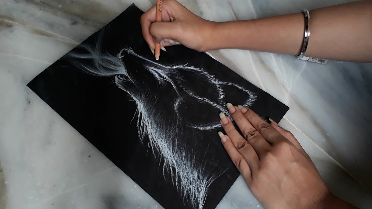 Drawing with white charcoal pencil the galaxy artist