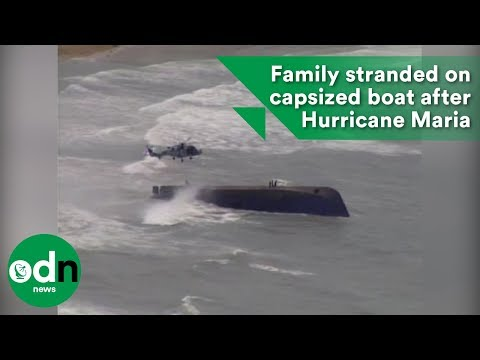 Family stranded on capsized boat after Hurricane Maria