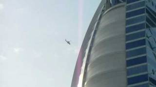 Helicopter leaves Burj Al Arab Dubai