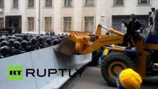 Ukraine: Protesters throw flares as a digger is driven through police barricade