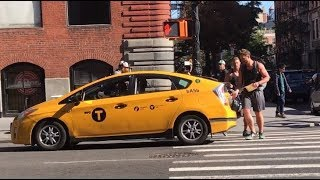 Amazing Race Contestants (Season 30) Hailing a Taxi in NYC