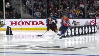 McDavid blows past MacKinnon, can't beat Larkin's record
