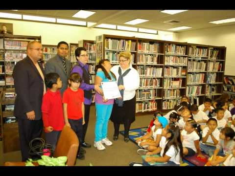 Bell Gardens Library Receives Check From Cesar Elementary