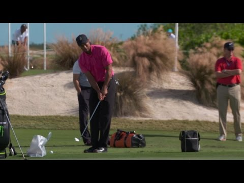 Tiger Woods practices his chipping and putting on Tuesday before Hero