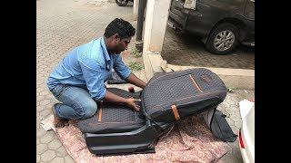 Applying car seat covers - Elegant Auto Accessories