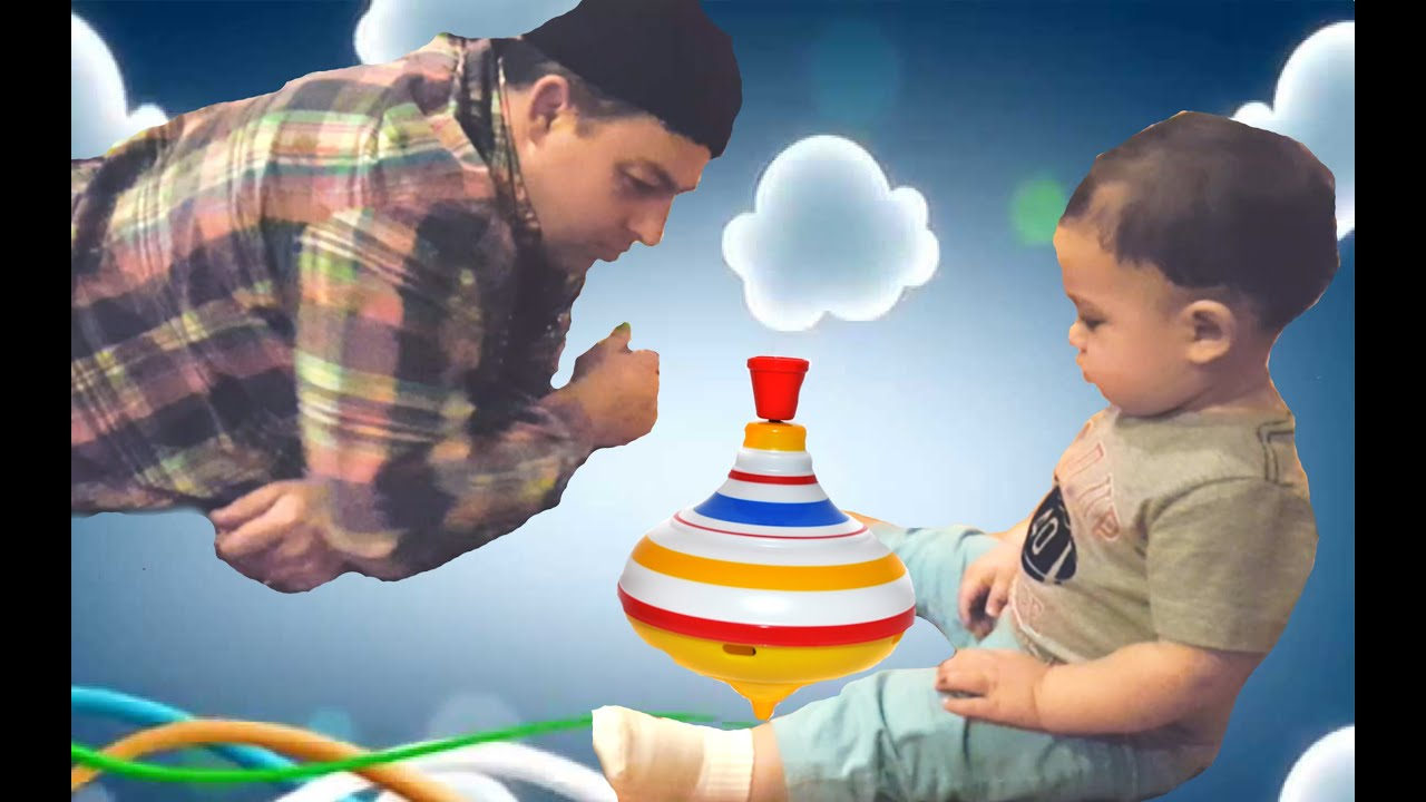 Little boy play top toy Kid playing with whirligig Video for kids