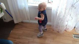 11 months old baby first time wears shoes.